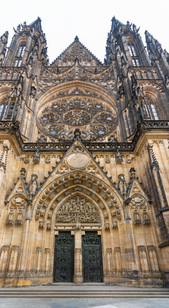Prague, Czech Republic. St. Vitus Cathedral and Gothic style of West entrance bronze doors, decorated with reliefs with scenes from history of the Cathedral and legends about St. Wenceslas and Adalber