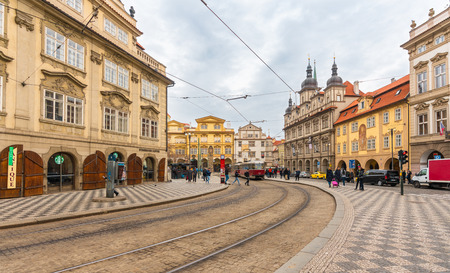 Prague, Czech Republic-February 01, 2019. Malostranske namesti is the main square of Prague's Mala Strana. St. Nicholas Church and the adjacent building complex divides the square in upper and lower. Zdjęcie Seryjne - 124999521