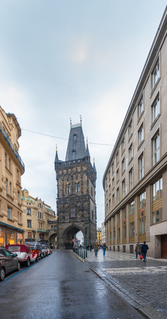 Prague, Czech Republic-February 2, 2019. Old Town street and Powder Tower, Gothic city gate to the old Prague. Todays name Powder tower has been used when it was used as a gun-powder storage.