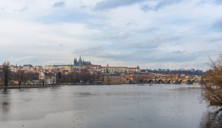 Prague, Czech Republic-January 31, 2019. View of Vltava river and historical, famous Old Town at late afternoon at Winter time on January 31, 2019 in Prague City.