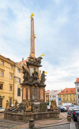Prague, Czech Republic-February 01, 2019. Column of the Holy Trinity in front of the Church of St Nicholas and is 20m high and decorated with a statue of the Holy Trinity and the Czech patron saints. 報道画像