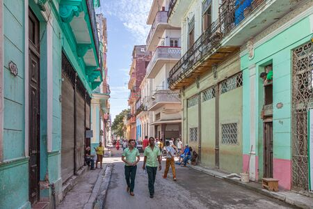 Havana, Cuba-October 07, 2016. Typical street of historical part of Old Havana with colonial times buildings and street life with local people.