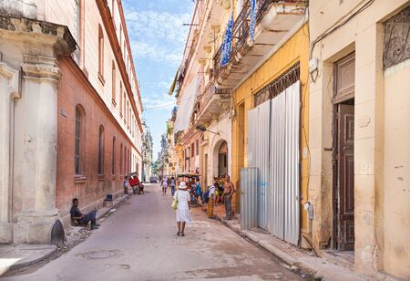 Havana, Cuba-October 07, 2016. View of authentic street with old colonial buildings and local people at every day life on October 07 2016, at old part of Havana City.