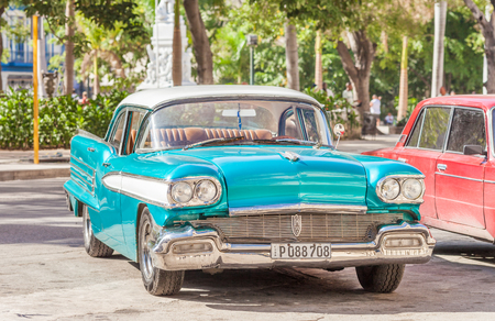 Vintage, classic American car parked at historical centre of Old Havana city in Cuba 報道画像