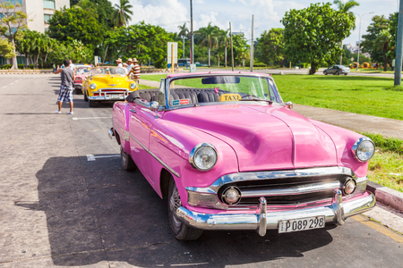 Havana, Cuba. Vintage, classic, old American cars, used as Taxi, parked at Revolution square.