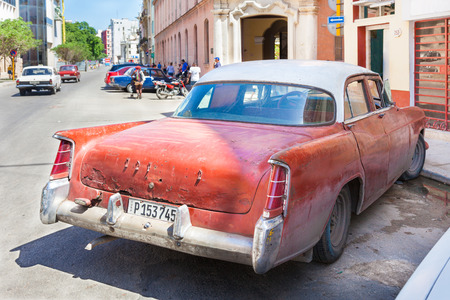 Cuba, old, long time used and rusty classic American car on the street of Old Havana.