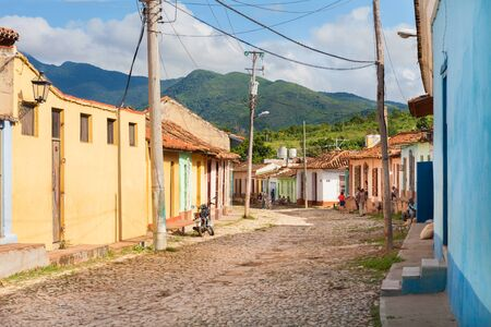 Trinidad, Cuba-October 14, 2016. View of street with colorful historical colonial style buildings and mountains at background in Trinidad town of Central Cuba. Editorial