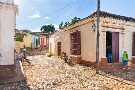 Trinidad, Cuba-October 14, 2016. Street with colorful historical colonial style buildings in Trinidad town centre, one of the first Cuban cities founded by the Spanish at Central Cuba.