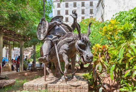 Havana, Cuba-October 07, 2016. Statue, made from metal, of character Sancho Panza on the donkey at the park of Old Havana. Sancho Panza is a fictional character in the novel Don Quixote written by Spanish author. Editorial