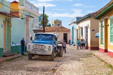 Trinidad, Cuba-October 14, 2016. Water suppliers delivers water in tanker trucks, because the antiquated water system unable to provide people with water. Editorial