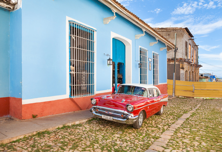 Trinidad, Cuba-October 14, 2016. Vintage American car parked on the cobblestone street of historical Trinidad, Spanish colonial town in Central Cuba.