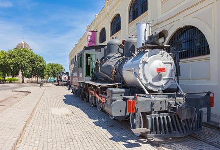 Havana, Cuba-October 8, 2016. Steam locomotives displayed outside the Almacenes San Jose Artisans' Market on October 8, 2016. in Old Havana, Cuba.