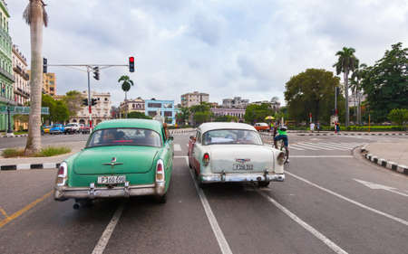 Havana, Cuba-October 7, 2016. Classic, old style American cars on the street at old part of Havana City in rainy day on October 7, 2016 in Cuba.