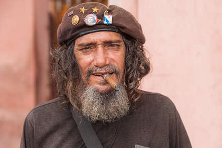Havana, Cuba-October 7, 2016. Portrait of Cuban man posing to the tourists dressed as Ernesto Che Guevara at historical town centre of Havana City on October 7, 2016 in Cuba. Editorial