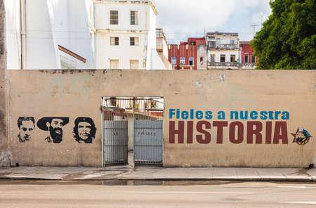 Havana, Cuba-October 7, 2016. Iconic painting of Julio Antonio Mella, Camilo Cienfuegos, Ernesto Che Guevara with words