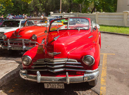 Havana, Cuba-October 7, 2016. Classic, old style American red car, used as taxi parked on the street at old part of Havana City on October 07, 2016 in Cuba. Editorial