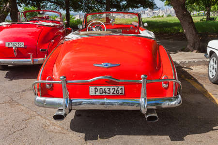 Havana, Cuba-October 7, 2016. Old style, classic American red car, used as taxi parked on the street at old part of Havana City on October 07, 2016 in Cuba.