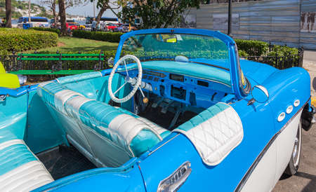 Havana, Cuba-October 7, 2016. Blue and white color interior of the old style, classic American car parked on the street at historical old part of Havana City on October 7, 2016 in Cuba.