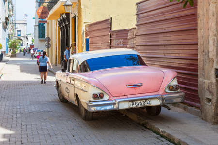 Havana, Cuba-October 7, 2016. Old, long time used and rusty classic American car on the street of Old Havana on October 7, 2016 in Cuba.