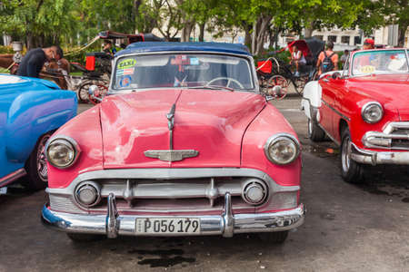 Havana, Cuba-October 07, 2016. Classic, old style, vintage, American car, used as taxi parked on the street at old part of Havana City on October 07, 2016 in Cuba. Editorial
