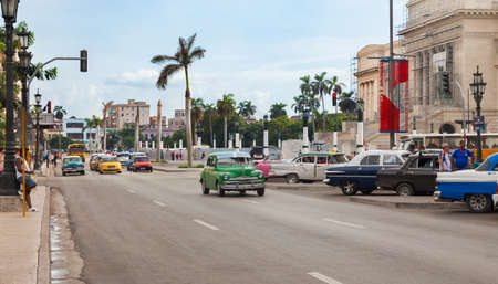 Havana, Cuba-October 07, 2016. Busy street scene with cars and people next to Capitolio at old part of historical Havana City on October 7, 2016 in Cuba. Editorial