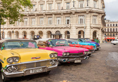 Havana, Cuba-October 07, 2016. Classic, old, American cars are parked near to Capitolio and waiting for tourists, as most of the cars are used as taxi nowadays in Cuba on October 07, 2016