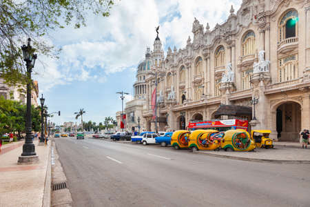 Havana, Cuba-October 07, 2016. View of the street with the colonial style, historical Great Theatre, cars and people on October 7, 2016 at old part of Havana City in Cuba.