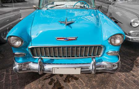 Havana, Cuba-October 8, 2016. Front of blue, vintage, classic, American car, parked and waiting for passengers, also very popular transportation for tourist on October 8,2016 at old part of Havana