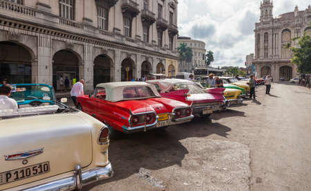 Havana, Cuba-October 07, 2016. Classic, old style, vintage, American cars parked next to the famous tourist attractions on October 07, 2016 at old part of Havana City, capital of Cuba.