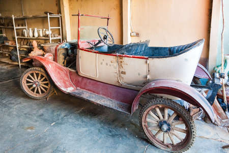 Trinidad, Cuba-October 14, 2016. One of the first old models of the Ford cars at the back yard of pottery home shop La casa del Alfarero on October 14, 2016 in Spanish town Trinidad.