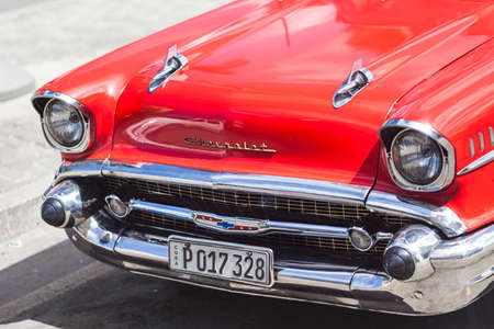 Havana, Cuba-October 09, 2016. Front of old style, classic, vintage, red American car on October 09, 2016 at historical Old Havana in Cuba . Editorial