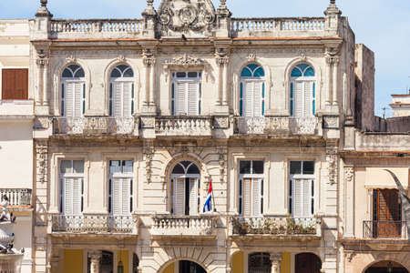 Havana, Cuba-October 08, 2016. Old, historical house exterior at the Old Square, Plaza Vieja, surrounded by architectural complex of colonial buildings from the XVII, XVIII, XIX and twenty century