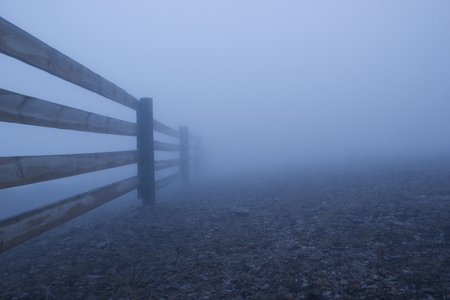 Dense fog and wooden fence
