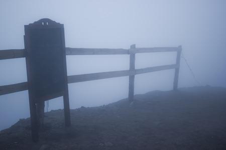 Chalk board and foggy fence