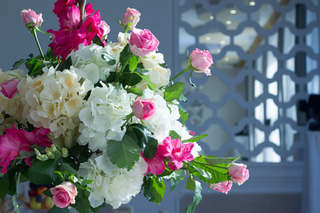 A bunch of beautiful artificial flowers in interior