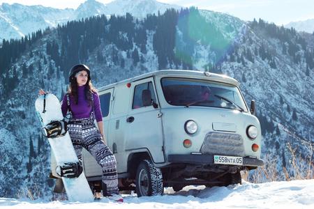 Almaty, Kazakhstan - January 10, 2019: UAZ 452 and snowboard burton girl in Tian-Shan mountain on freeride