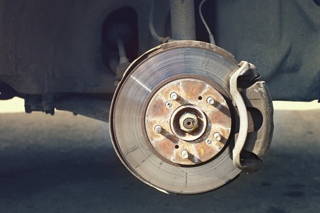 A car brake disc with stopping support without wheels closeup view Reklamní fotografie