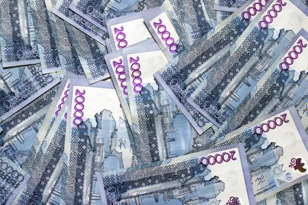 Flat lay view on 20,000 tenge qazaq national currency background