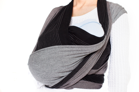 Close up view on craddle position in front cross carry wrap in woven wrap baby carrier