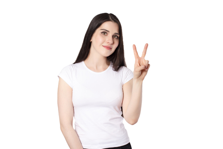 Attractive emotional young woman with a white t-shirt isolated Stockfoto