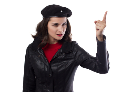 Young woman black jacket, red sweater and hat with a reference to cuban leader hand raised with index finger on a white background