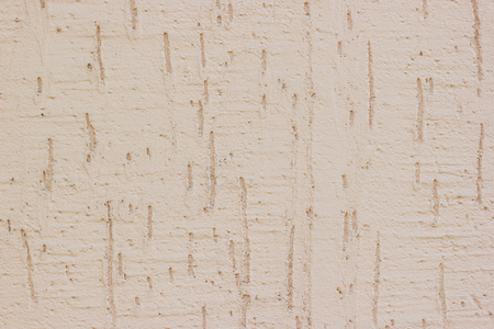 Texture of a area with Munich plaster wall roughcast light peach colour