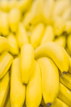 Fresh clear banana sunny yellow background texture vertical