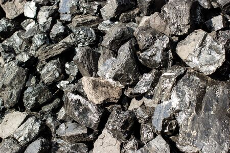 Pile of natural black hard coal for texture background. Grade anthracite coals often referred to as stone coal and black diamond coal.