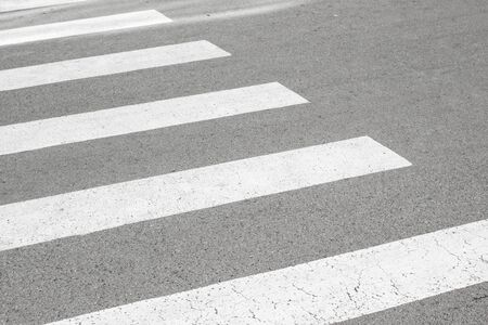 Zebra crossing painted on the asphalt traffic information for pedestrians and drivers