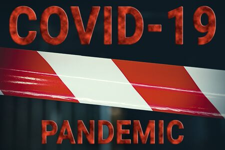 Covid-19 pandemic. Red and white, striped protective tape protects the enclosed area. Coronavirus concept