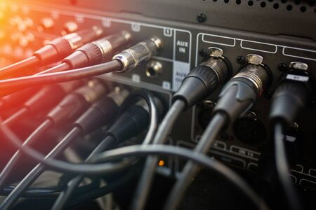 Close up audio jacks cable plugged into mixer console. XLR audio cable Imagens