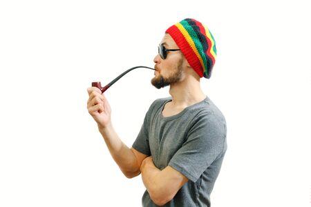 Young caucasian rasta man in jamaica hat, sunglasses and grey t-shirt on white Stock Photo
