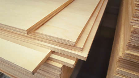 Plywood sheets in the store. Wooden panel stacked. Lumber is sold at the supermarket in the warehouse.