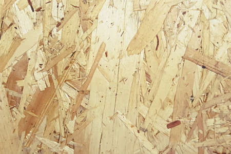 Pressed wooden shavings panel, texture of oriented strand board, OSB background 写真素材